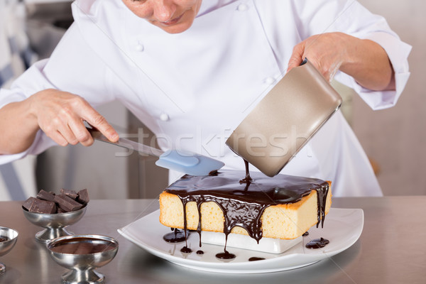 Pastry chef in the kitchen Stock photo © fotoedu