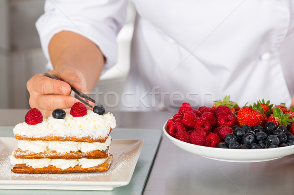 Pastry chef decorating Stock photo © fotoedu