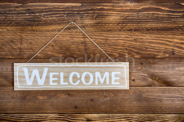 Bem-vindo cartaz rústico parede casa Foto stock © fotoedu