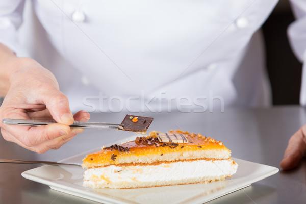 Stock photo: Pastry chef decorating