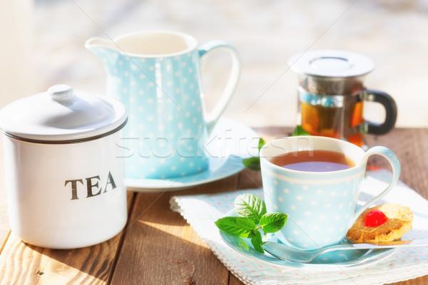 Csésze teáscsésze forró tea finom sütik Stock fotó © fotoedu