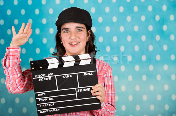 Teenage girl with a film clapperboard Stock photo © fotoedu