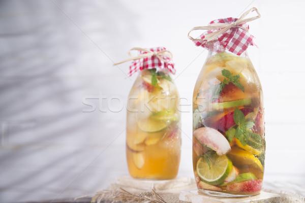 Infúzió tea barack citrom üveg gyümölcs Stock fotó © Fotografiche