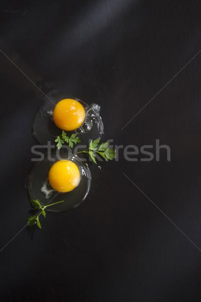 Fraîches brut oeuf présentation oeufs noir Photo stock © Fotografiche