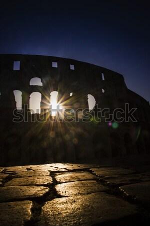 Colosseum şafak geri ışık gökyüzü Stok fotoğraf © Fotografiche