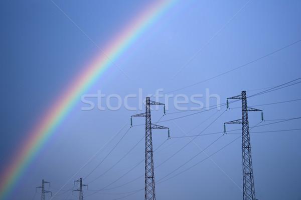 Rainbow through power line Stock photo © Fotografiche