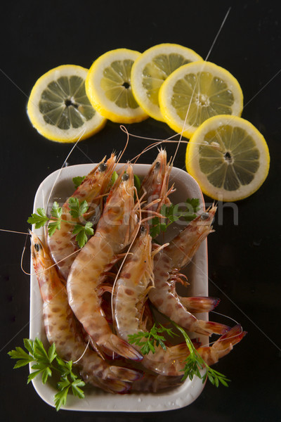 Crustaceans on black background Stock photo © Fotografiche