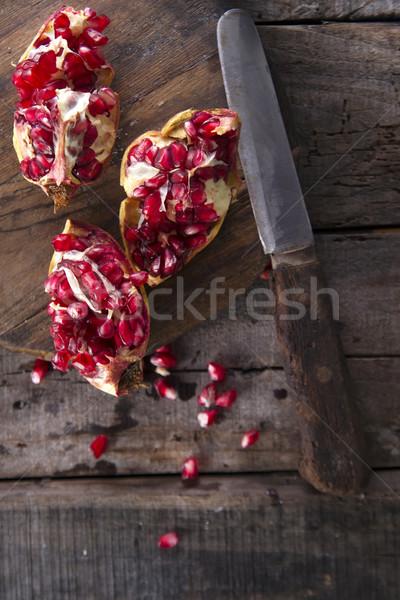 Gránátalma magok bemutató fa sötét gyümölcs Stock fotó © Fotografiche