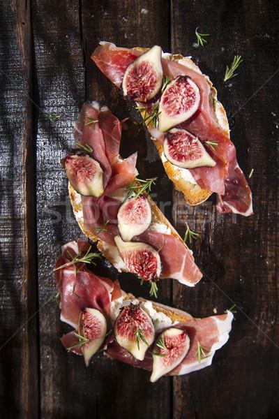 Prosciutto bruschetta bemutató fa asztal étel fa Stock fotó © Fotografiche
