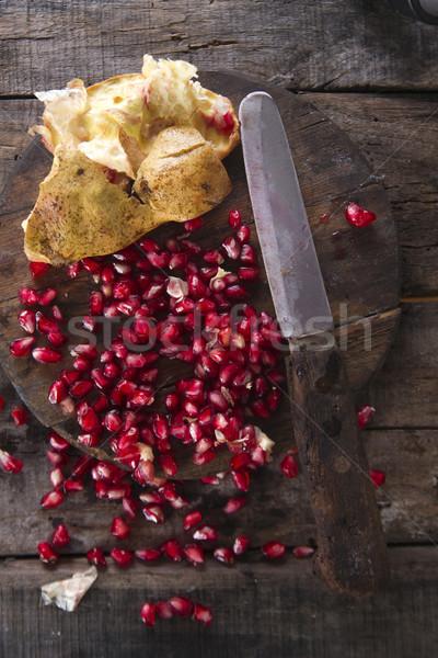 Romã sementes apresentação madeira escuro fruto Foto stock © Fotografiche