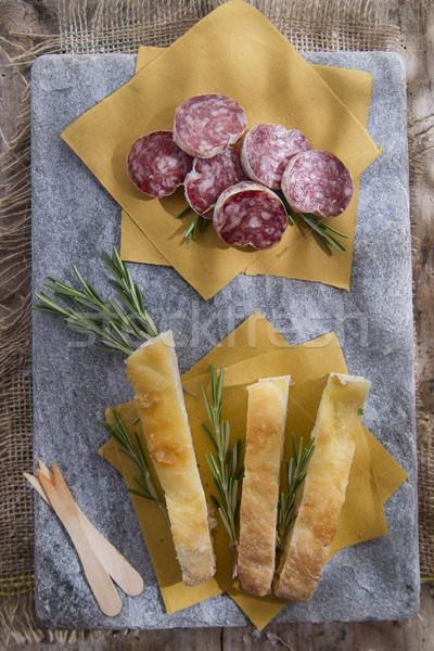 Szalámi bemutató tipikus toszkán kenyér vacsora Stock fotó © Fotografiche