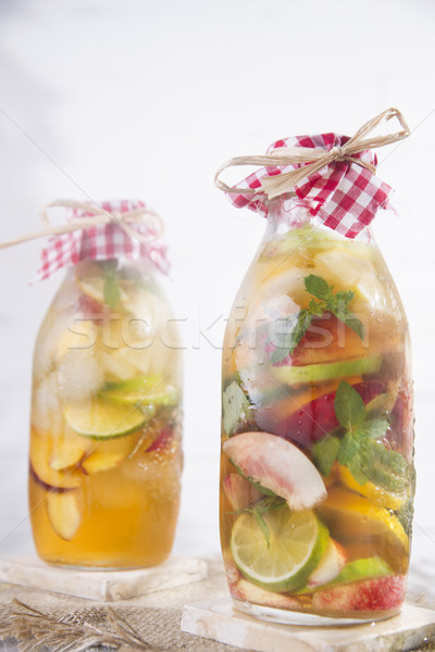 Infusie thee perzik citroen fles vruchten Stockfoto © Fotografiche