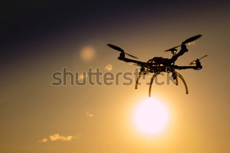Quadrocopter in flight at sunset Stock photo © Fotografiche