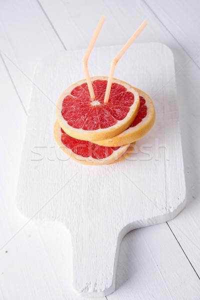 Slices of red grapefruit  Stock photo © Fotografiche