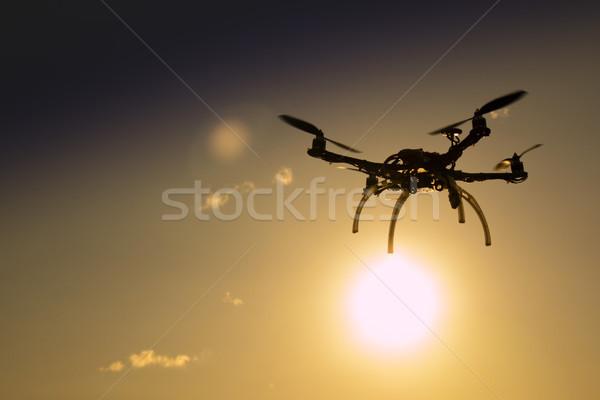 Uçuş gün batımı gökyüzü teknoloji kablosuz hareket Stok fotoğraf © Fotografiche