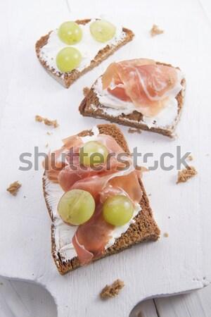Bread, cheese and ham and grapes  Stock photo © Fotografiche