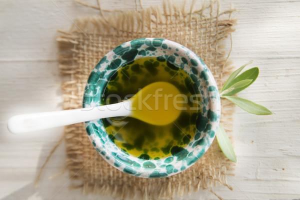 Faible contenant supplémentaire vierge huile d'olive présentation Photo stock © Fotografiche