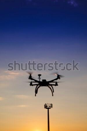Uçuş dört an gün batımı bulutlar model Stok fotoğraf © Fotografiche