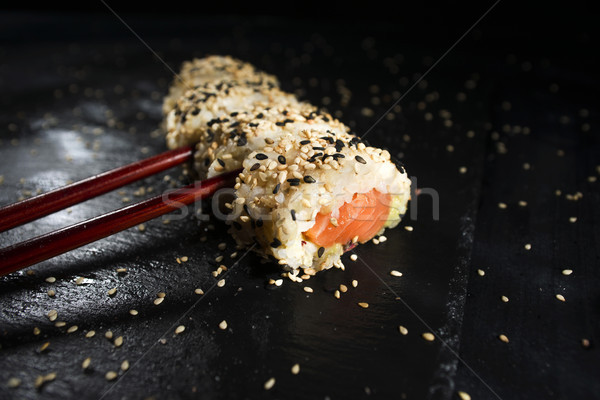 Sushi yemek Çin yemek çubukları tanıtım plaka siyah Stok fotoğraf © Fotografiche