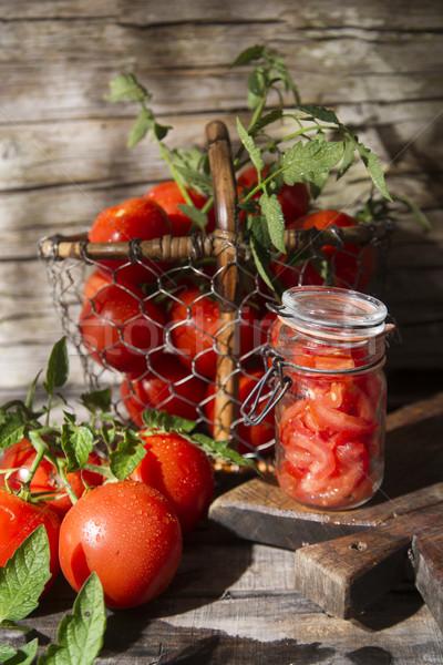 Jar of tomato pieces Stock photo © Fotografiche