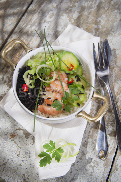 Black and white risotto with shrimp and zucchini Stock photo © Fotografiche