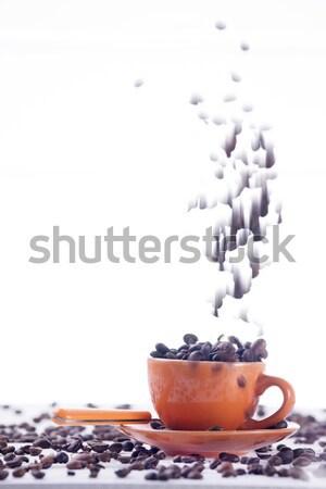 Csésze kávéscsésze kávé narancs fehér bab Stock fotó © Fotografiche
