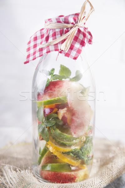 вливание чай персика лимона бутылку фрукты Сток-фото © Fotografiche