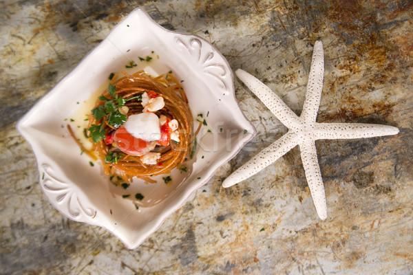 Spaghetti with scallops Stock photo © Fotografiche