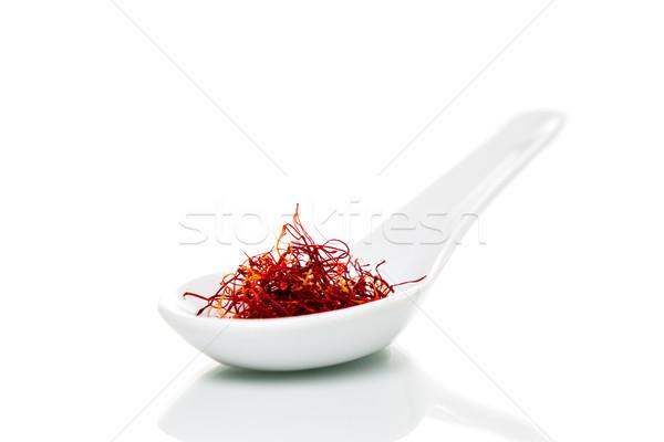 Saffron (Crocus sativus) threads on porcelain spoons Stock photo © fotoquique