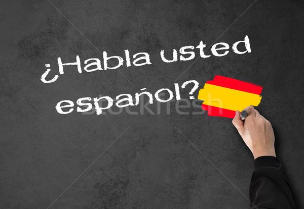 Beszéd spanyol üzletember fal iroda iskola Stock fotó © fotoquique