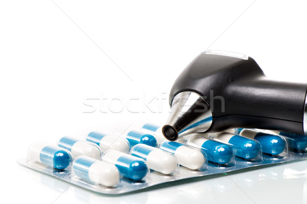 Otoscope on a blister of tablets Stock photo © fotoquique