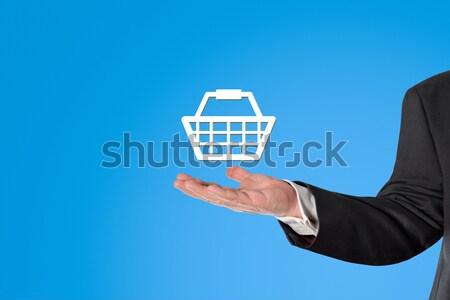 üzletember tart virtuális kosár kéz férfi Stock fotó © fotoquique