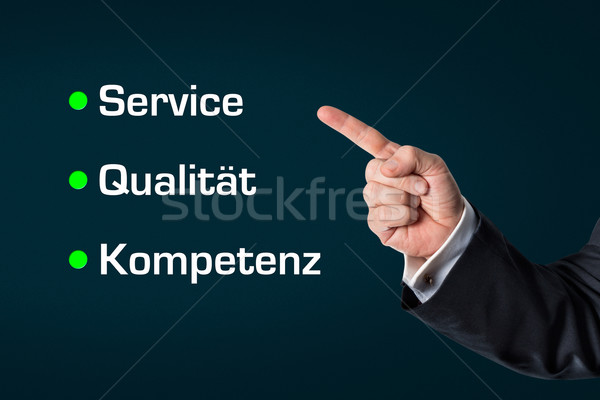 Business man pointing at the words -Service, Quality, Competence Stock photo © fotoquique