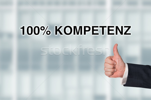 Business man pointing at the words 100% competence Stock photo © fotoquique