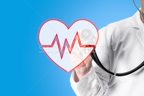 Doctor holding stethoscope in hand Stock photo © fotoquique