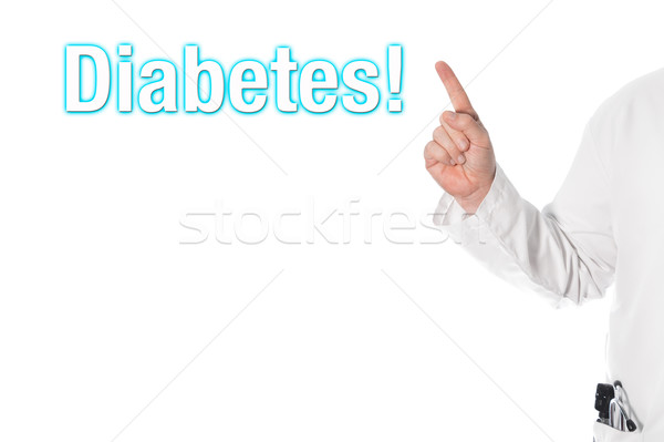 Médecin pointant titre diabète doigt titre Photo stock © fotoquique