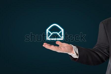 Businessman holding a virtual letter symbol Stock photo © fotoquique