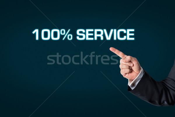 üzletember mutat szavak 100 szolgáltatás sötét Stock fotó © fotoquique