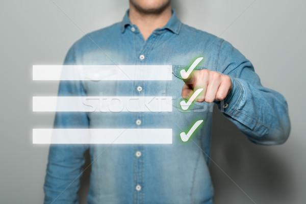 Man pointing virtual checklist Stock photo © fotoquique