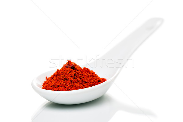 Paprika poeder porselein lepels geïsoleerd keuken Stockfoto © fotoquique
