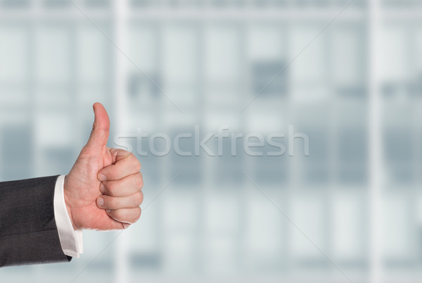 Business man holding a thumb up Stock photo © fotoquique