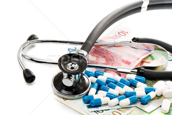 Számlák sztetoszkóp tabletták izolált utazás pénzügy Stock fotó © fotoquique