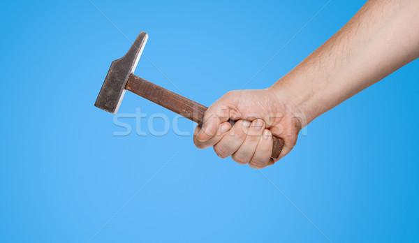 Férfi tart kalapács kéz vágási körvonal kék Stock fotó © fotoquique