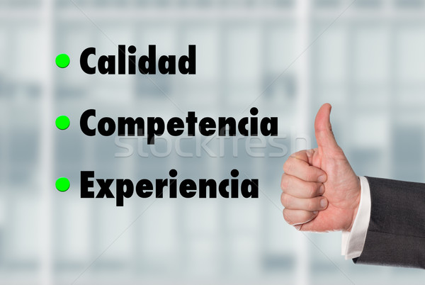 Business man holding a thumb up, Quality-Competence-Experience Stock photo © fotoquique