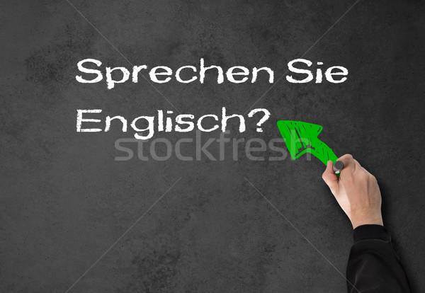 Férfi beszéd angol fal üzletember szürke Stock fotó © fotoquique