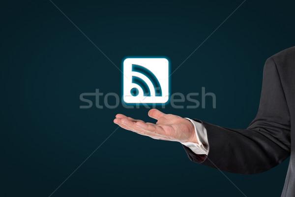Businessman holding a virtual WiFi symbol Stock photo © fotoquique