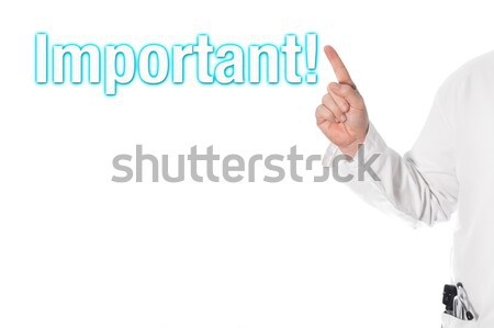 Doctor pointing at a title important Stock photo © fotoquique