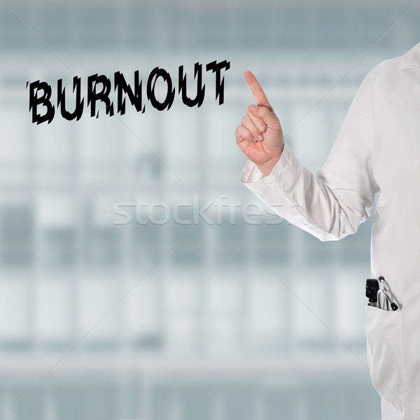 Doctor pointint at the word Burnout Stock photo © fotoquique