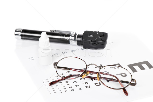 Ophthalmoscope, eye test and glasses Stock photo © fotoquique