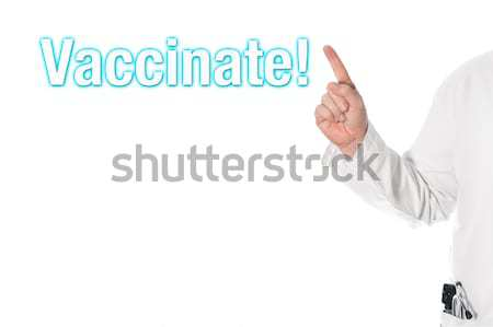Doctor pointing at a title (attention) Stock photo © fotoquique